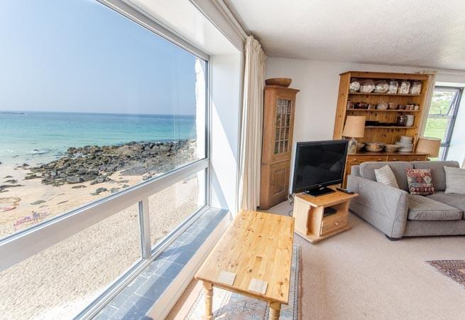 The enviable view over Portmeor Beach from the sitting room.