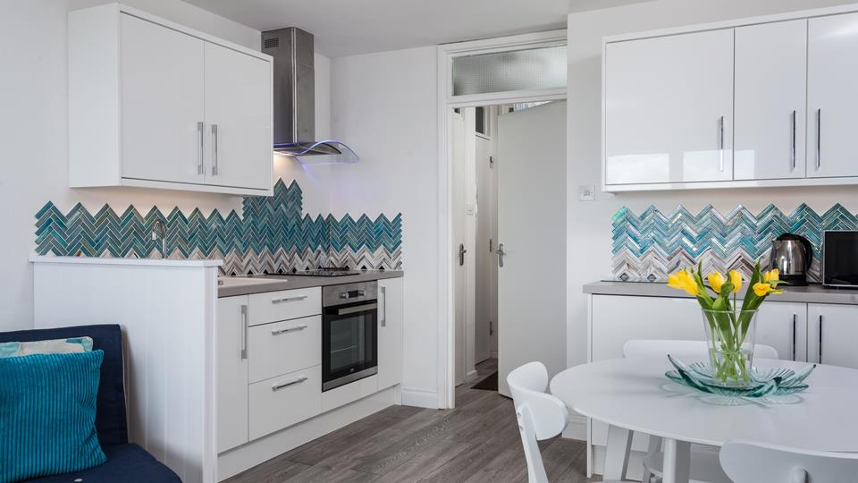 The unique tiles add a splash of colour to the modern kitchen.