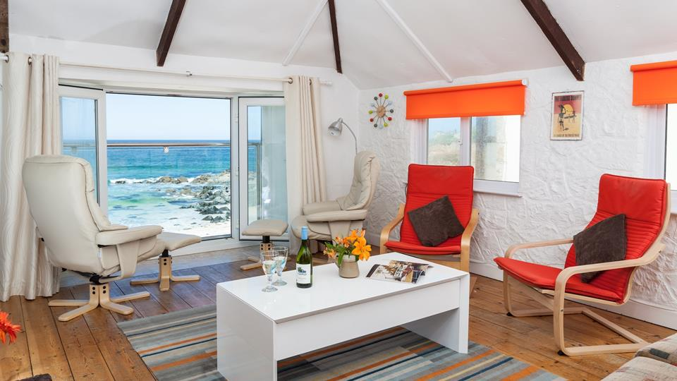 The sitting room has a spectacular view onto Porthmeor Beach, with french doors opening onto a Juliet balcony.
