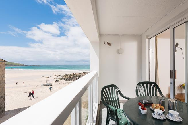 Balcony with patio furniture and views of Porthmeor Beach.