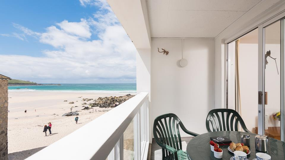 Balcony with patio furniture and views of Porthmeor Beach.