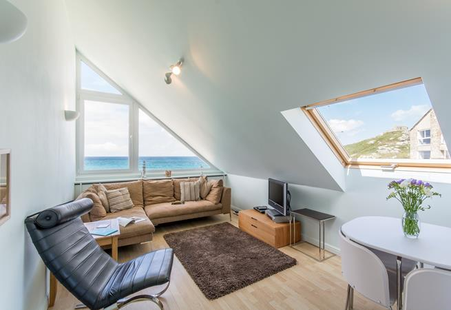 Open plan sitting/dining room with fabulous sea views.