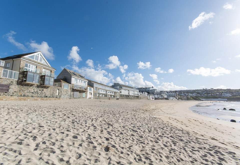 The golden sands of Porthmeor beach are literally just below your balcony.