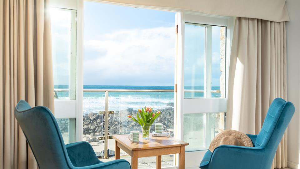 Balcony with panoramic sea views leading out from double bedroom.