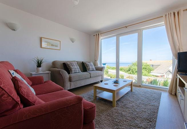 Cosy up in the living area with the gas fire or enjoy the view with the doors open in the summer.