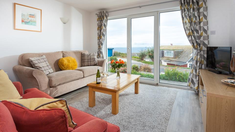 Bright seaside colours give the room a wonderful summery feel.
