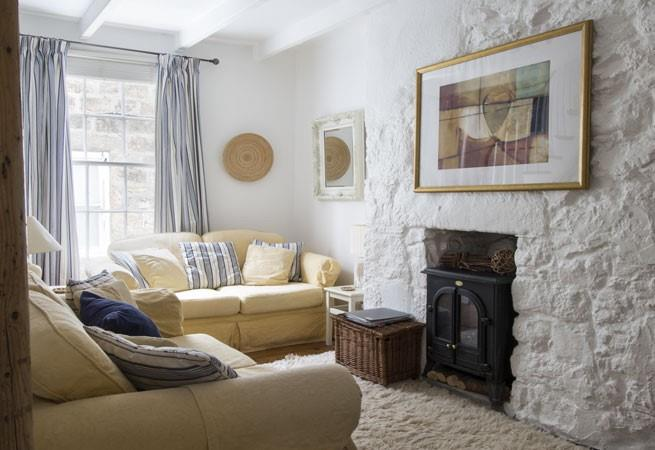 The sitting room with sofas and a feature fireplace