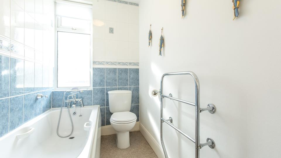 Family bathroom has a bath with shower attachment, WC and basin.