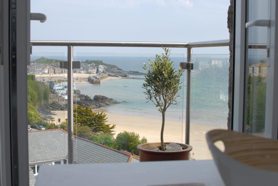 The full width balcony with glass surround and panoramic views.