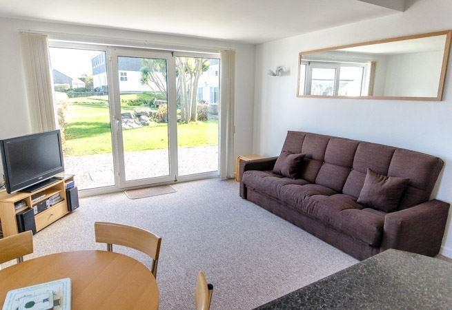 Open plan sitting room with double sofa bed.