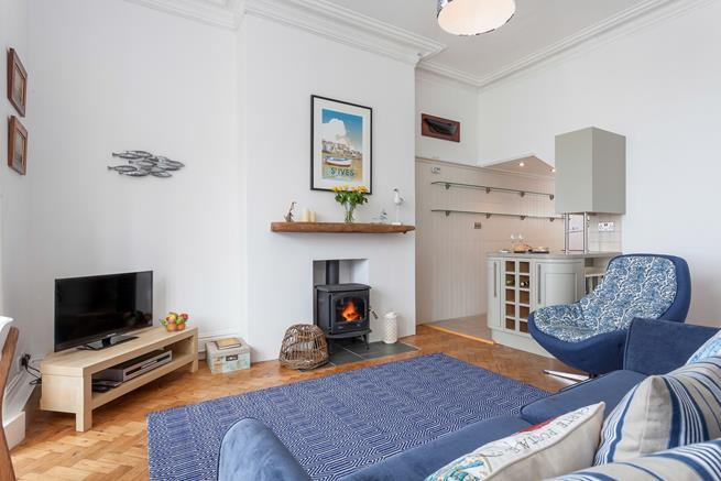 Comfy sitting area with coal effect gas fire.