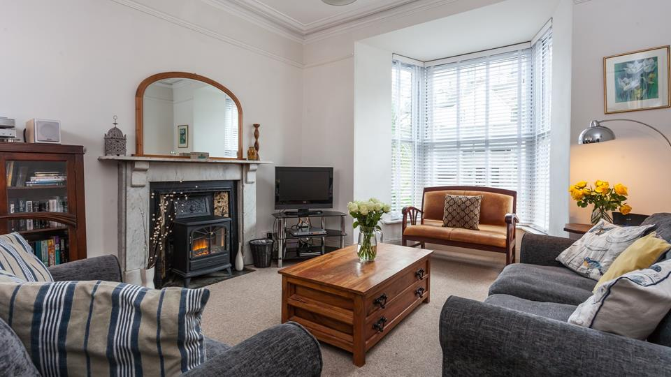 The living area has a Victorian style fireplace surround with an overmantle arched mirror above.