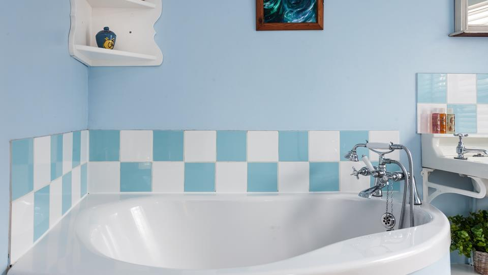 The family bathroom has a pale Cornish blue colour scheme which produces a cool, crisp and clean-lined look.