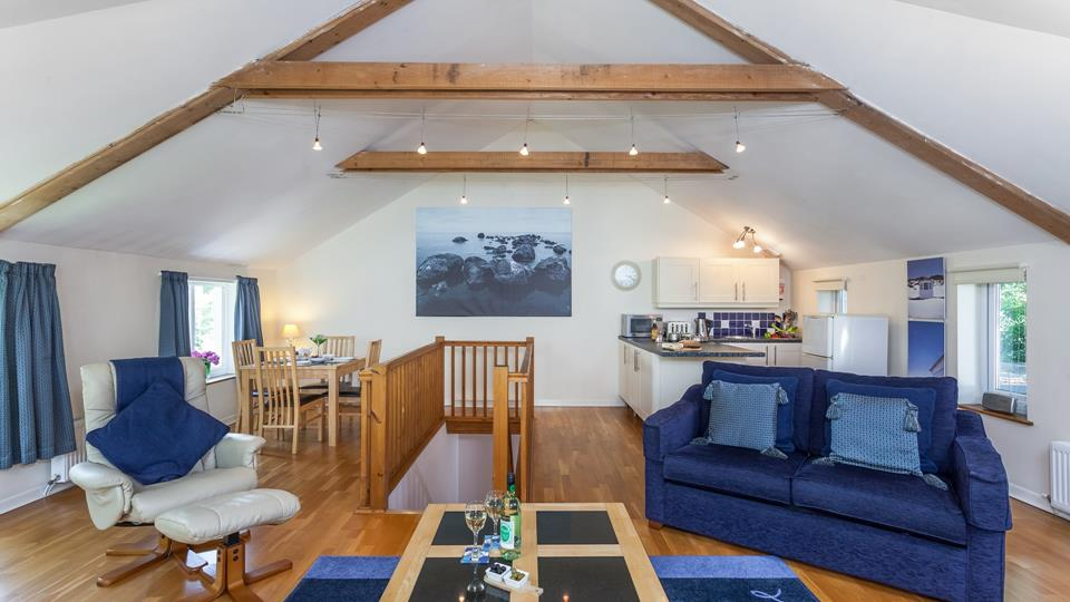 The high vaulted ceiling and open plan living give the room a spacious feel.