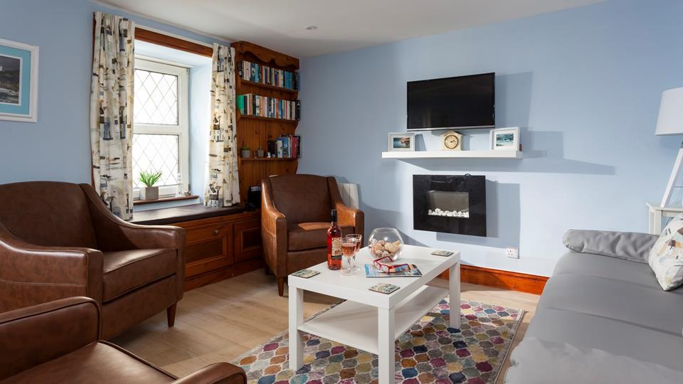 Relax and watch TV in the cosy, homely lounge.