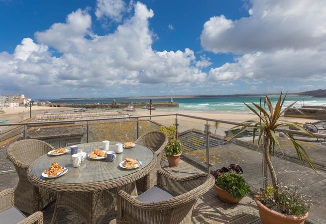 Dine al fresco on the terrace overlooking stunning St Ives.