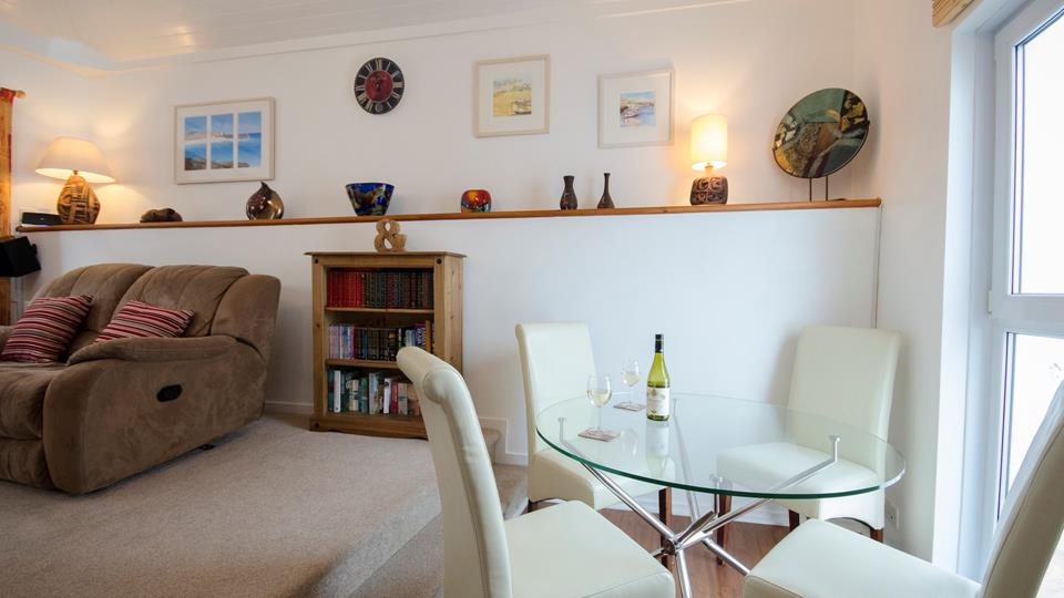 Few steps up from kitchen/dining area to sitting room.