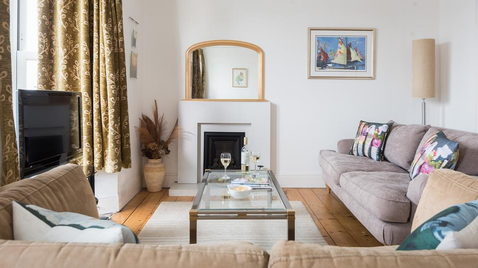 The comfortable sitting room is complete with a good-sized TV which is perfect for catching up on your favourite shows.