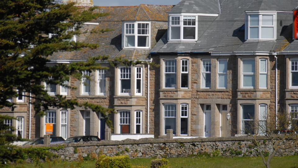 The Captain's House is a terraced house with traditional granite-faced bay windows and dormer windows in the bedrooms to take full advantage of the sea views.