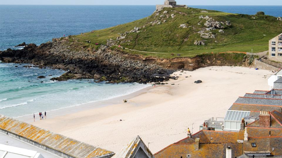 Porthmeor beach and the headland are really stunning the soft sand and turquoise sea are totally lush.