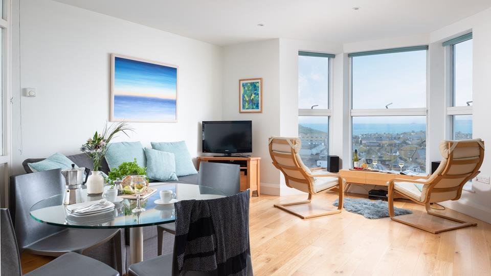 The living space has a triple aspect bay window, overlooking St Ives town and bay.