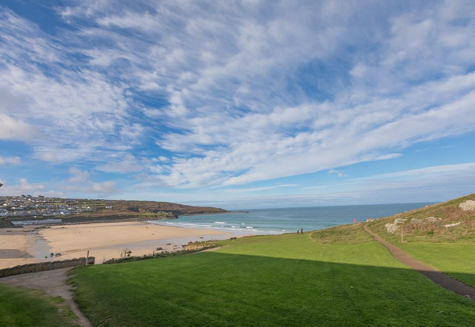 Views of The Island and Porthmeor beach from the patio and the sitting room.