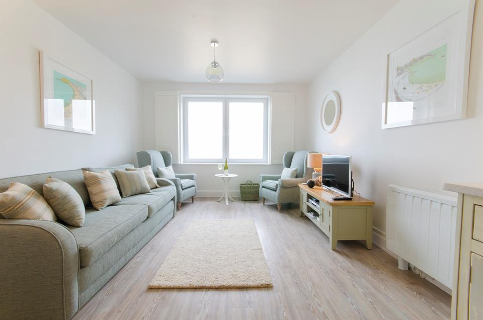 Beautifully presented sitting room with  sofa, two armchairs and TV/DVD player.