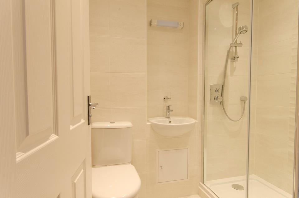 Shower room with WC and basin.