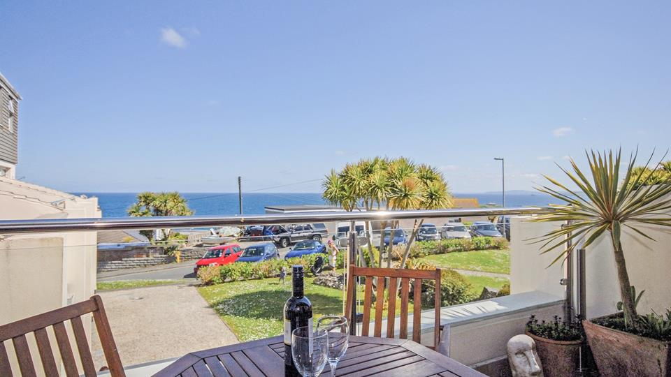 The beautiful sea view from the private partially glass and steel balustrade balcony is stunning.