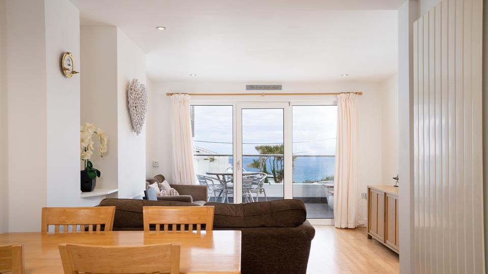 Bright and airy, the open plan living area offers a fabulous place to relax and socialise.