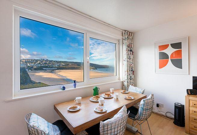 Large picture window with sea and beach views from the dining area.