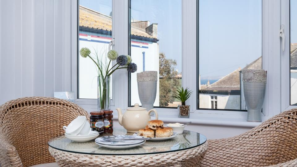 Enjoy afternoon tea in the rattan furniture.