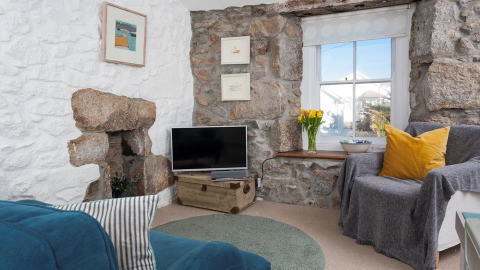 This traditional cottage has an abundance of character, with its original stone walls.
