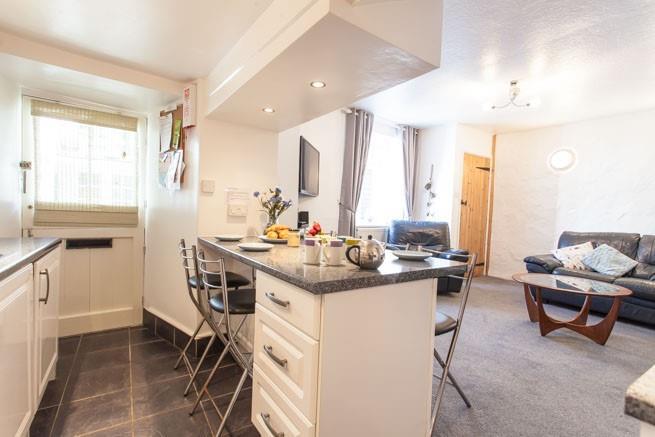 Open plan kitchen/dining sitting area.