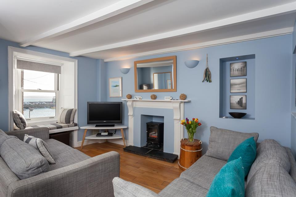 The sitting room with TV/DVD and views over the harbour