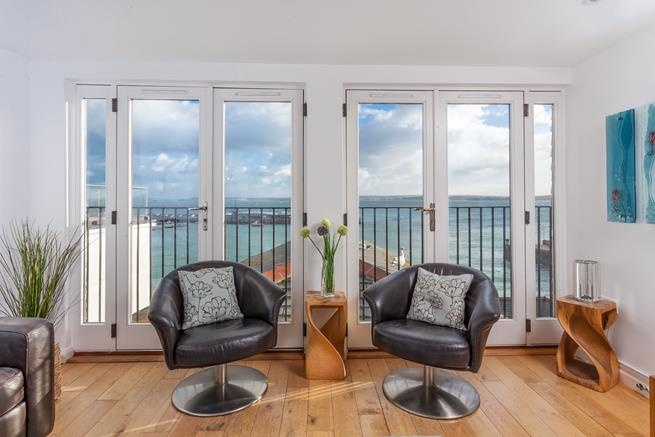 Breath taking harbour views from the floor to ceiling double French doors.