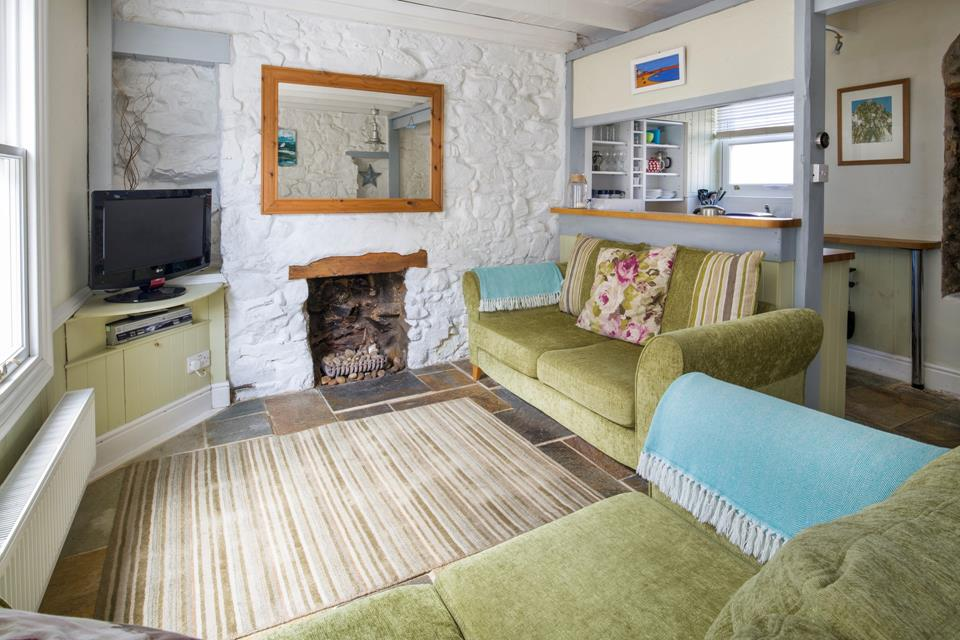 Cosy open plan living with many original features.