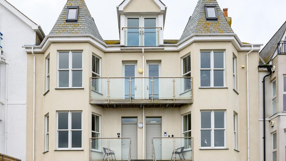 The apartment has a Victorian-style facade with glass and stainless balustrading balconies.