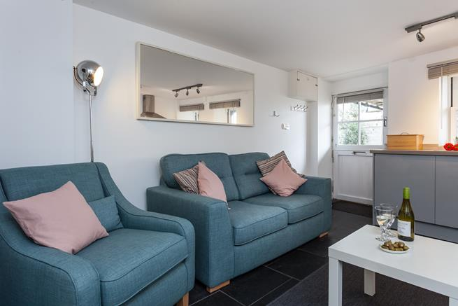 Enjoy a glass of wine on the comfy sofa with harbour views.