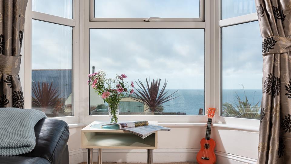 Bay windows embrace the serene back drop.