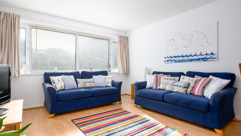 Two comfy large sofas, perfect for relaxing on.
