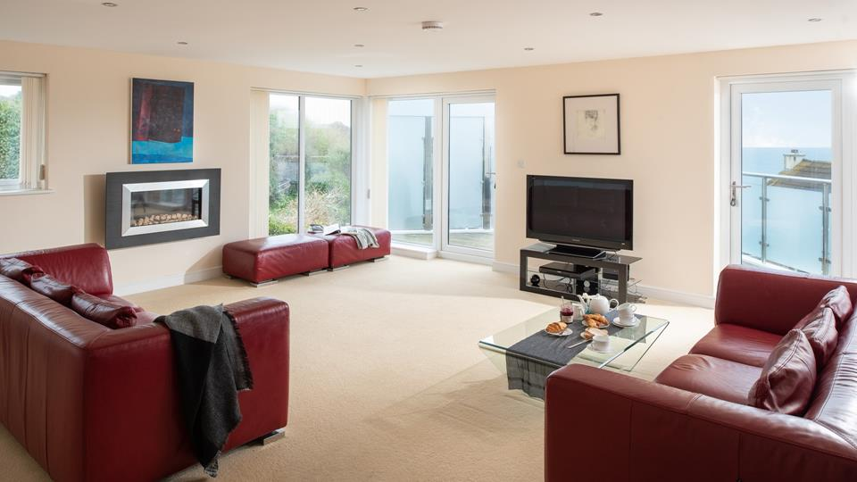 Light and airy, with doors onto the balcony this room is a perfect social space.