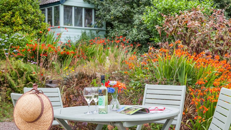 Outside, pleasant table and chairs are available for you to enjoy an afternoon cream tea or an evening drink among the flora and fauna.