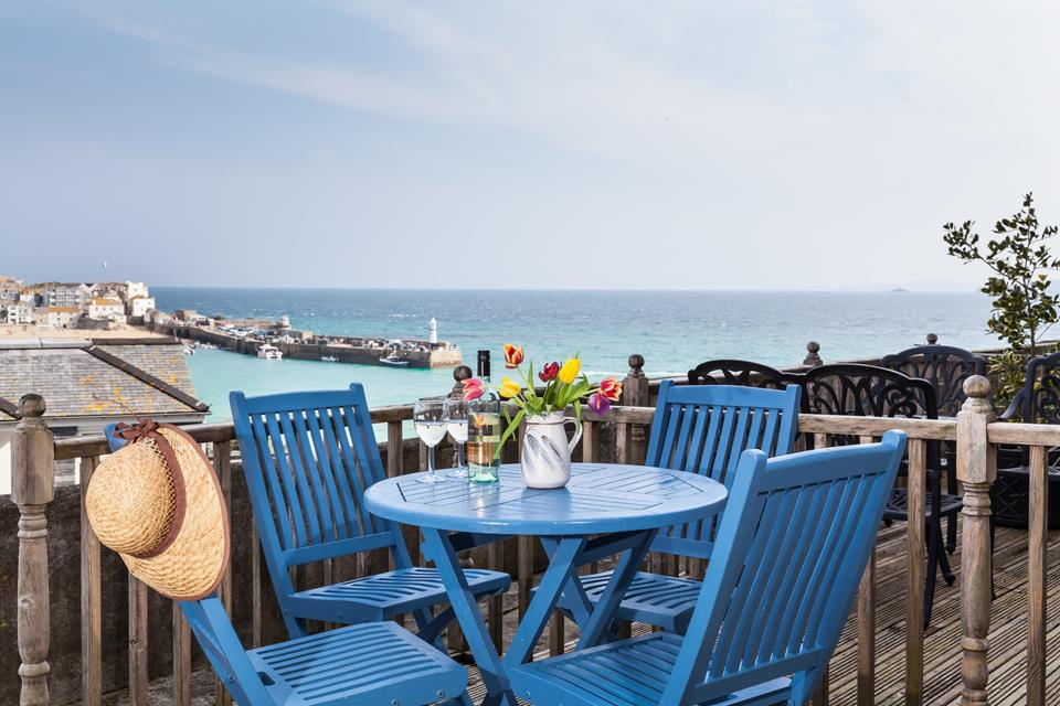 Large decked terrace with expansive views of St Ives harbour, the bay and Godrevy Lighthouse.