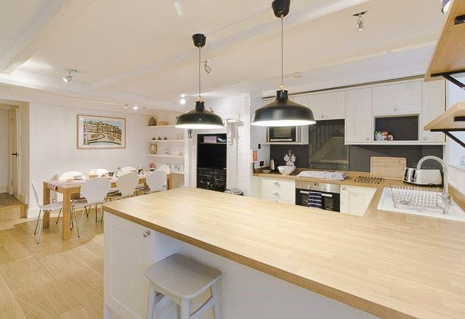Large spacious kitchen and dinning area, perfect for family meals.
