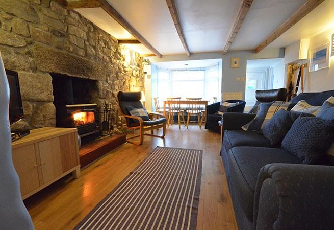 Sitting/dining room with woodburner and TV/DVD