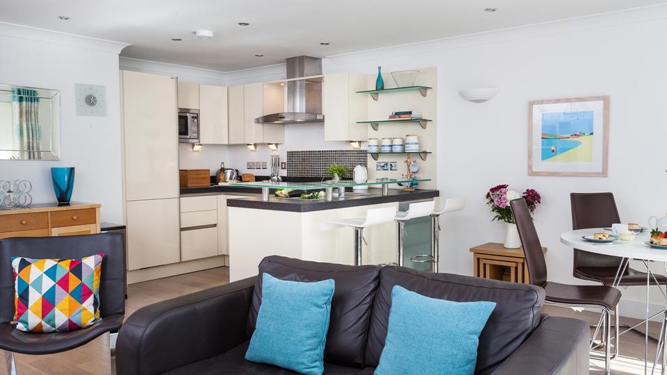Modern kitchen with breakfast bar, fridge/freezer and dishwasher.