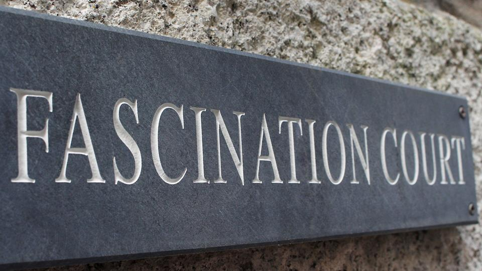 A traditional local slate sign is the perfect medium and looks great against the traditional granite stone face wall.