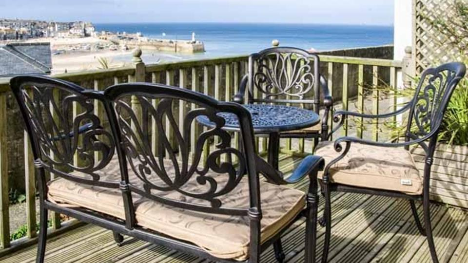 Stunning sea views from the large private decked terrace complete with dining furniture.