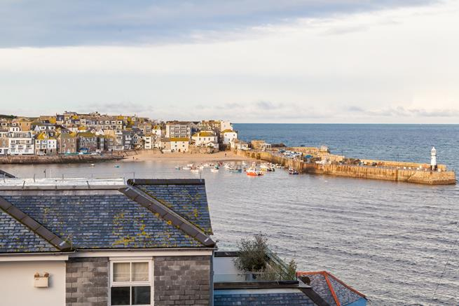 Stunning sea views of St Ives Harbour and across the bay to the Godrevy Lighthouse and beyond from the decked terrace.